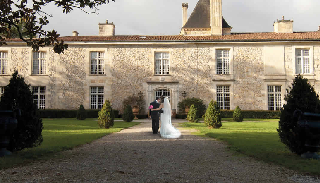 Bride and Groom entering the Château