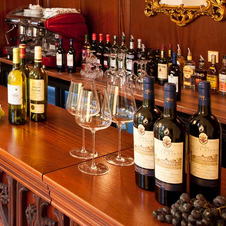 Image of bottles of wine sitting on bar